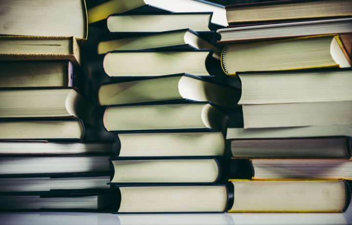 The books are placed in a stack of books on the table